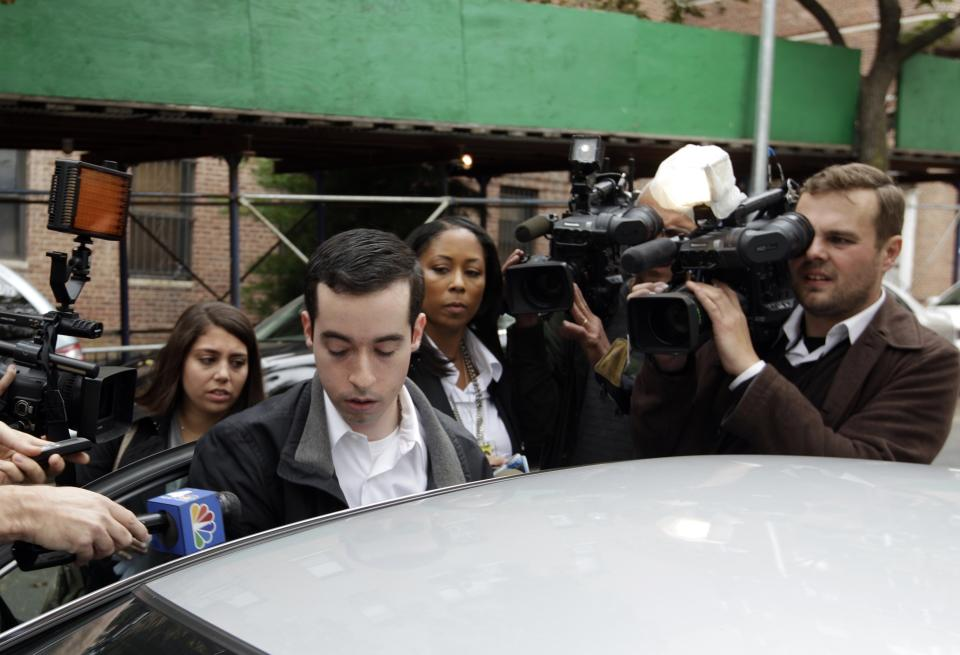 A man claiming to be the brother of New York City Police Officer Gilberto Valle is questioned by the media  Thursday, Oct. 25, 2012, in the Queens borough of New York. The officer was charged Thursday in a ghoulish plot to kidnap and torture women and then cook and eat their body parts.   (AP Photo/Frank Franklin II)