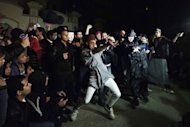 "Egyptian actvists and youth perform the Internet craze the ""Harlem Shake"" in front of the Muslim Brotherhood headquarters in Cairo on February 28, 2013"