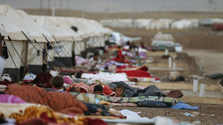 Displaced people from the minority Yazidi sect, who fled violence in the Iraqi town of Sinjar, sleep on the ground at Bajed Kadal refugee camp, southwest of Dohuk province
