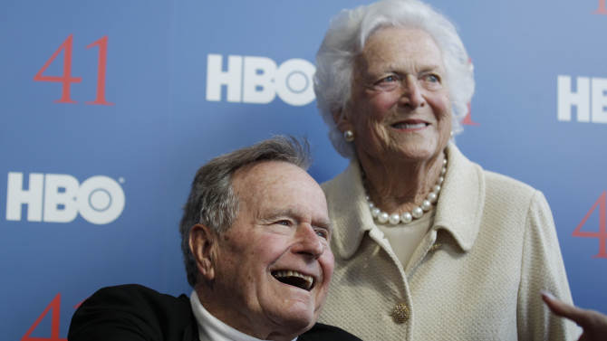 FILE - In a Tuesday, June 12, 2012 file photo, former President George H.W. Bush, and his wife former first lady Barbara Bush, arrive for the premiere of HBO's new documentary on his life near the family compound in Kennebunkport, Maine. The 41st president, hospitalized since Nov. 23, 2012, continues to recover at a Houston hospital where he's being treated for a bronchitis-related cough.  (AP Photo/Charles Krupa, File)