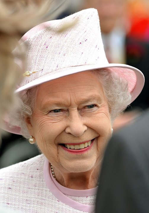 Queen Elizabeth II talks to guests at the garden party for Olympians, Paralympians and London 2012 officials (PA)