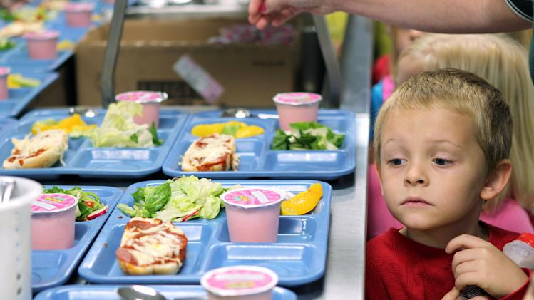 "In this Tuesday, Nov. 1, 2011 file photo pre-K student Titus Bailey waitd in line for his lunch tray at West Hamlin Elementary School in West Hamlin, W. V. The nation's school districts are turning up their noses at ""pink slime,"" the beef product that caused a public uproar earlier this year. The U.S. Department of Agriculture says the vast majority of states participating in its National School Lunch Program have opted to order ground beef that doesn't contain the product known as lean finely textured beef. (AP Photo/The Herald-Dispatch, Lori Wolfe)"
