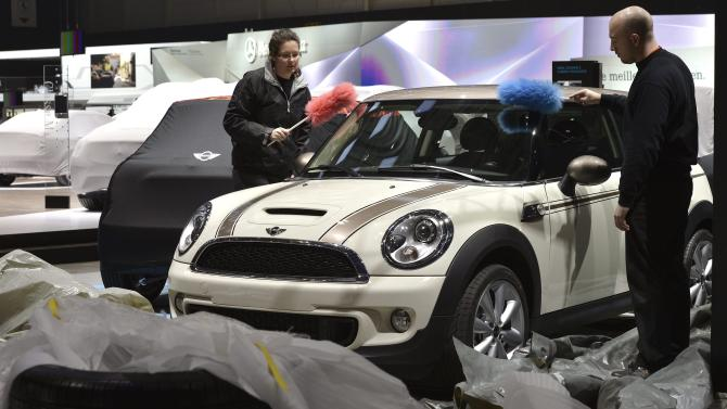 Workers dust a car at the Mini booth during last preparations prior to the opening of the press preview days at the 83nd Geneva International Motor Show in Geneva, Switzerland, Saturday, March 2, 2013. The Motor Show will open its gates to the public from March 7 to 17, presenting more than 260 exhibitors and more than 130 world and European premieres. (AP Photo/Keystone, Martial Trezzini)