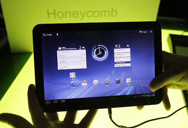 FILE - In this Feb. 2, 2011 file photo, a Motorola Mobility Xoom tablet is shown at Google headquarters in Mountain View, Calif. On Monday, Aug. 13, 2012, Google announced it is cutting about 4,000 jobs at its Motorola Mobility cellphone business and will close or consolidate about one-third of its 90 locations. (AP Photo/Paul Sakuma, File)