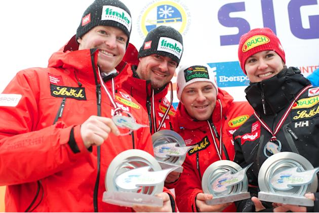 (L TO R) Austria's Andreas Linger, Wolfgang Linger, Manuel Pfister and Nina Reithmayer celebrate after placing second in the Luge Team Relay event of the Luge World Cup in Sigulda on February 19, 2012