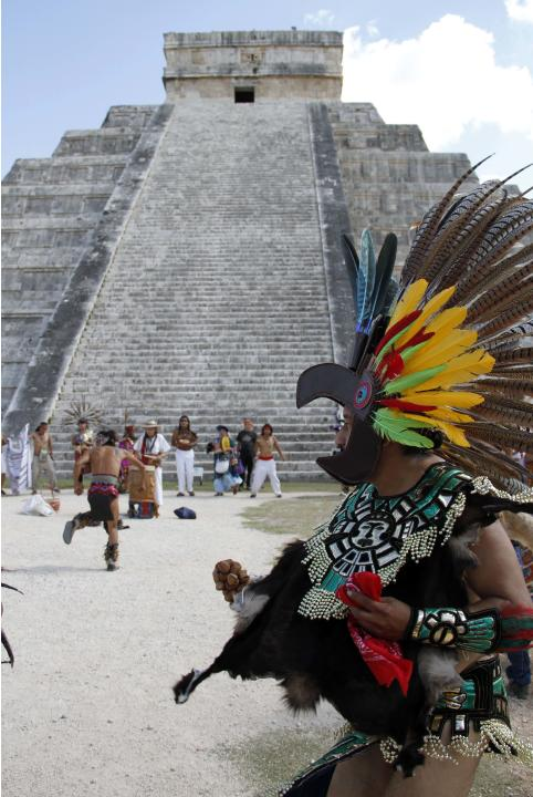 Mayan dancers perform in front of the Kukulkan Pyramid in Chichen Itza, Mexico, Thursday, Dec. 20, 2012. American seer Star Johnsen-Moser led a whooping, dancing, drum-beating ceremony Thursday in the