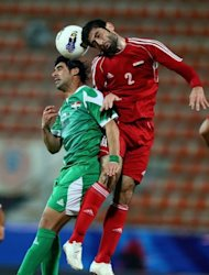 Ahmad al-Salih (R) of Syria vies for the ball against Iraq's Hammadi al-Daea (L) during the final of the 7th West Asia Football Federation championship in Kuwait City, on December 20, 2012. Syria won 1-0