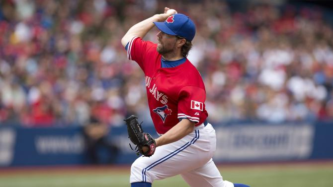 Toronto Blue Jays starting pitcher R.A. Dickey pitches during first inning of a baseball game against the Detroit Tigers in Toronto, Monday, July 1, 2013. (AP Photo/The Canadian Press, Frank Gunn)