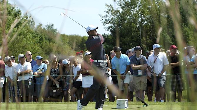 Tiger Woods hits from the third tee during the first round of the Deutsche Bank Championship golf tournament at TPC Boston in Norton, Mass., Friday, Aug. 31, 2012. (AP Photo/Stew Milne)