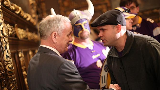 A Vikings fan thanked Gov. Mark Dayton, left, after the stadium bill passed in the House Monday night, May 7, 2012 at the Capitol in St. Paul, Minn. The Minnesota House has approved a plan to build a $975 million stadium for the Vikings, but with a big boost in what the team would pay.  (AP Photo/The Star Tribune,Renee Jones Schneider )  MANDATORY CREDIT; ST. PAUL PIONEER PRESS OUT; MAGS OUT; TWIN CITIES TV OUT