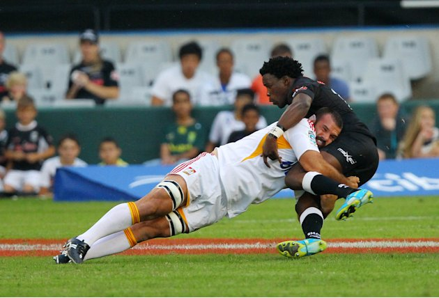 New Zealand Waikato Chiefs' Alex Bradley (L) tackles Sharks of Durban's Lwazi Mvovo during the Super 15 rugby union match Sharks of Durban vs Waikato Chiefs of New Zealand at the Mr Price Kings Park R