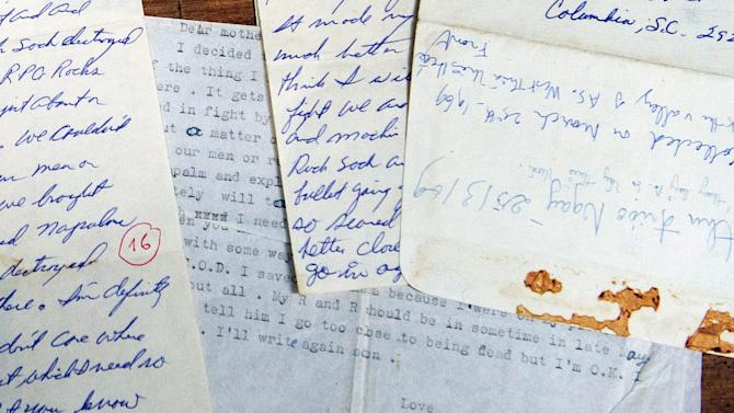 The personal letters of U.S. Army Sgt. Steve Flaherty, who was killed in action in 1969, rest on a table at Joint POW/MIA Accounting Command (JPAC) in Hanoi, Vietnam Monday, June 4, 2012. Vietnamese Defense Minister Phuong Quang Thanh presented the letters to U.S. Defense Secretary Leon Panetta during a press conference at the defense ministry. (AP Photo/Jim Watson, Pool)