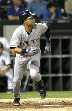 New York Yankees' Derek Jeter watches his home run off Chicago White Sox starting pitcher Chris Sale during the sixth inning of a baseball game, Wednesday, Aug. 22, 2012, in Chicago. (AP Photo/Charles Rex Arbogast)
