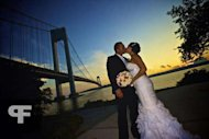 Here, we see the beautiful reception dress as the couple pose for photos beneath the Verrazano Bridge.