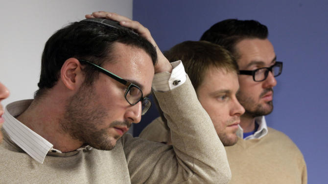 "Chaim Levin, left, and Michael Ferguson,  right,  with his partner Seth Anderson, listen to a a news conference, in New York, Tuesday, Nov. 27, 2012. Levin, of the Crown Heights neighborhood of Brooklyn. NY, and Ferguson, of Salt Lake City, are two of four gay men accusing a New Jersey organization of selling ""conversion therapy"" services promising to make them straight. Instead, they told the news conference that they were subjected to humiliations, including having to strip naked, or taking a baseball bat to effigies of their mothers.  (AP Photo/Richard Drew)"