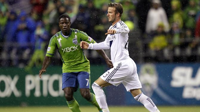 Seattle Sounders' Eddie Johnson (7) squares off against Los Angeles Galaxy's David Beckham, right, in the first half of the MLS Western Conference championship soccer match, Sunday, Nov. 18, 2012, in Seattle. (AP Photo/Ted S. Warren)