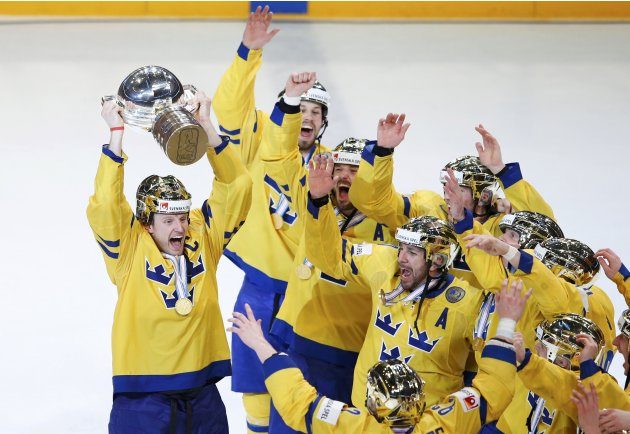 Sweden's gold medallists celebrate with trophy their victory over Switzerland in their 2013 IIHF Ice Hockey World Championship final match at the Globe Arena in Stockholm