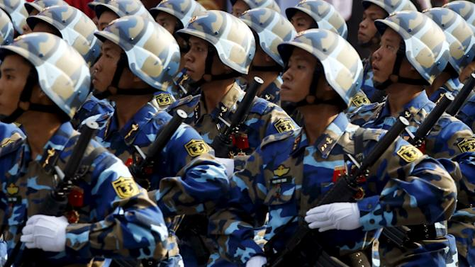 Soldiers of the marine patrol force march during a rehearsal for a military parade as part of the 40th anniversary of the fall of Saigon, in southern Ho Chi Minh City, Vietnam