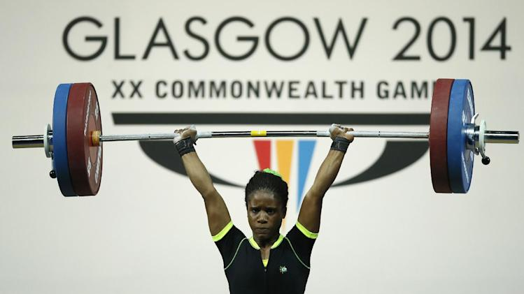 Chika Amalaha of Nigeria, makes good lift during the women's 53 kg weightlifting competition at the Commonwealth Games Glasgow 2014, in Glasgow, Scotland, Friday, July, 25, 2014. Amalaha won the gold medal in the event.(AP Photo/Alastair Grant)