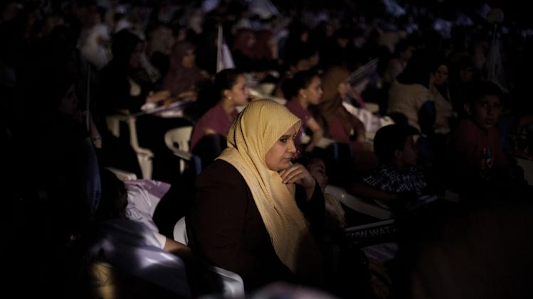 In this Wednesday, July 4 , 2012 photo, a Libyan woman attends an Al Wattan Party rally at the seaport of Tripoli, Libya. The Libyan National Assembly elections will take place on July 7, 2012. It will be the first free elections since 1969. (AP Photo/Manu Brabo)