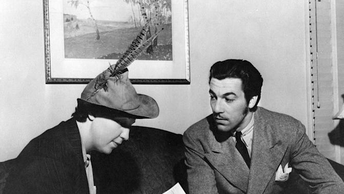 In this photo provided by the National Archives at College Park, an enumerator interviews actor Cesar Romero, right, to get data for the 1940 Census. Veiled in secrecy for 72 years because of privacy protections, the 1940 U.S. Census is the first historical federal decennial survey to be made available on the Internet initially rather than on microfilm. (AP Photo/National Archives at College Park)