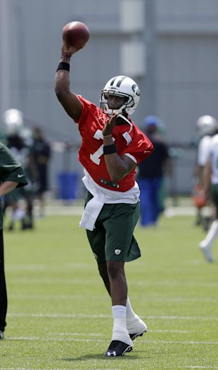 On Day 1 of training camp, Geno Smith got the most first-team snaps among the QBs. (AP)