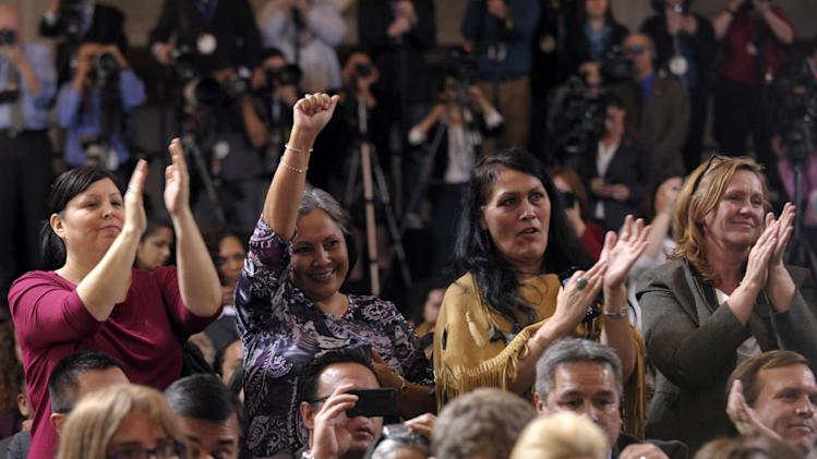 The audience reacts to remarks by President Barack Obama, Thursday, March 7, 2013, at the Interior Department in Washington, before the president signed the Violence Against Women Act. (AP Photo/Susan Walsh)