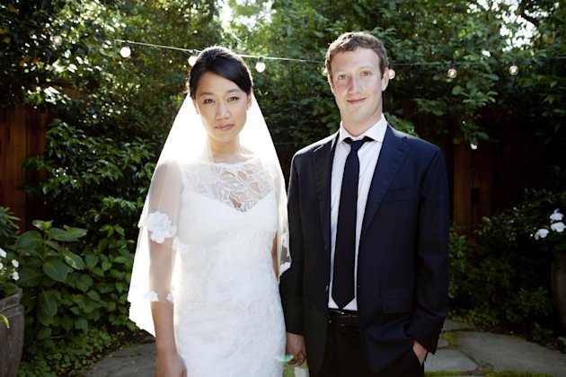 "This photo provided by Facebook and released on Tuesday, May 22, 2012, shows Facebook founder and CEO Mark Zuckerberg and Priscilla Chan at their wedding ceremony in Palo Alto, Calif., Saturday, May 19, 2012. Zuckerberg updated his status to ""married"" on Saturday. The ceremony took place in Zuckerberg's backyard before fewer than 100 guests, who all thought they were there to celebrate Chan's graduation. (AP Photo/Facebook, Noah Kalina Photography)"