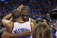 Oklahoma City Thunder's Kevin Durant (R) hugs teammate Russell Westbrook after they defeated the Dallas Mavericks in Game One of the Western Conference Quarterfinals in the 2012 NBA Playoffs on April 28