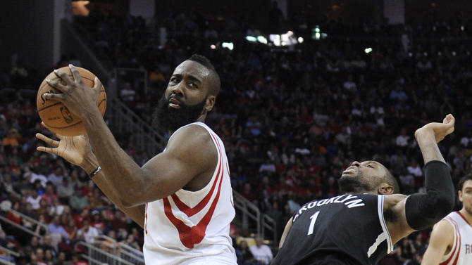 FILE - This Jan. 26, 2013 file photo shows Brooklyn Nets' C.J. Watson (1) backing away from Houston Rockets' James Harden (13) in the second half of an NBA basketball game in Houston. The Rockets won 119-106. In his first season with the Rockets after an October trade from Oklahoma City, Harden has already grown fond of the nation's fourth-largest city. He sat down with The Associated Press to give those planning a trip for the event tips on where to stay, what to eat and things to do.  (AP Photo/Pat Sullivan, file)