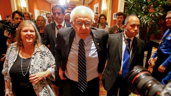 Democratic U.S. presidential candidate, Senator and his wife, Jane O'Meara Sanders, leave the first official Democratic candidates debate of the 2016 presidential campaign in Las Vegas