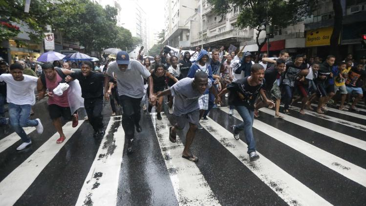 Residents of Pavao-Pavaozinho slum protest in the Copacabana streets against the death of Douglas Rafael da Silva Pereira in Rio de Janeiro