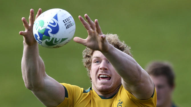 Australian rugby player David Pocock catches the ball during training in  Wellington,  New Zealand, Friday, Oct. 7, 2011.   Australia will play South  Africa in the Rugby World Cup quarter finals on Sunday Oct. 9.(AP Photo/Rob Griffith)