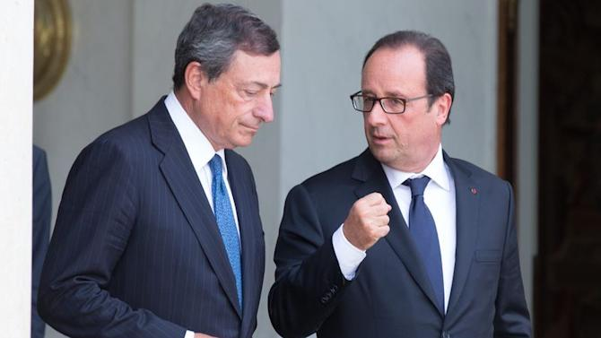 French President Francois Hollande speaks with European Central Bank President Mario Draghi at the Elysee Palace in Paris