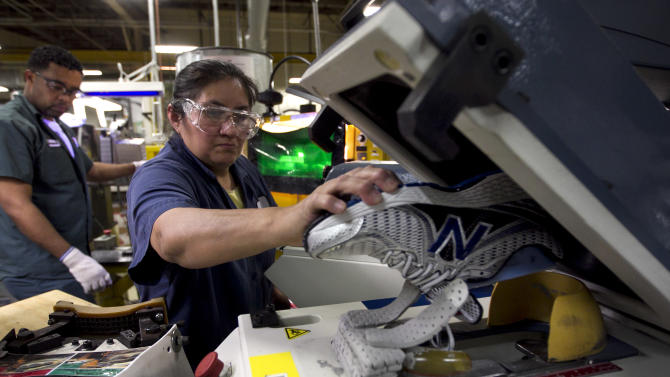 FILE - In this Tuesday, May 1, 2012, file photo, worker Maria Contrero, of Boston, removes an elite running shoe from a sole press during the assembly process at the New Balance Athletic Shoe, Inc. factory in Boston. A U.S. economy that plodded along in the first three months of the year likely grew even less in the April-June quarter. And most economists no longer think growth will strengthen much in the second half of 2012.  (AP Photo/Steven Senne, File)