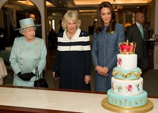 The royal women admire a Diamond Jubilee-themed cake