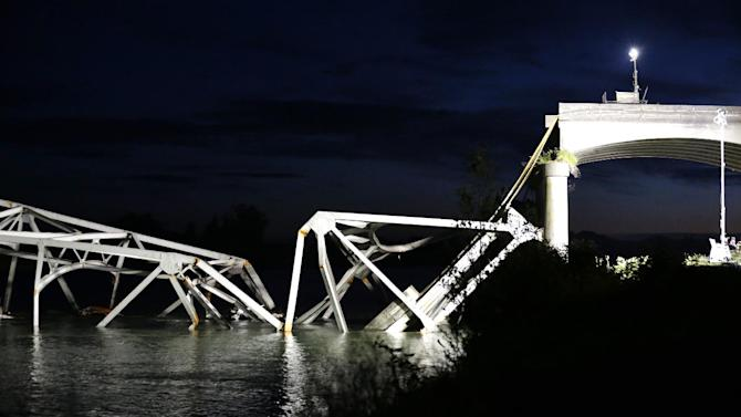The collapsed Interstate-5 bridge is seen in ruins and partially submerged in the Skagit River in Mount Vernon, Wash., Thursday, May 23, 2013. At least two vehicles went into the river in the collapse. (AP Photo/Elaine Thompson)