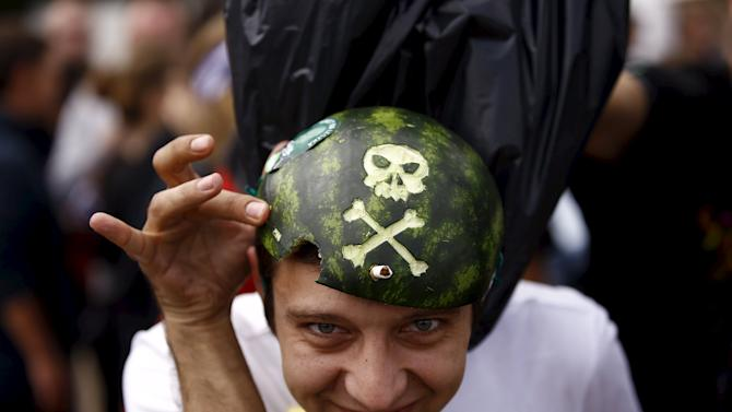 A man shows his watermelon hat during the 21st Woodstock Festival in Kostrzyn-upon-Odra
