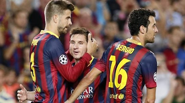 Barcelona's Gerard Pique (L) is congratulated by Lionel Messi (C) and Sergio Busquets (R) (Reuters)