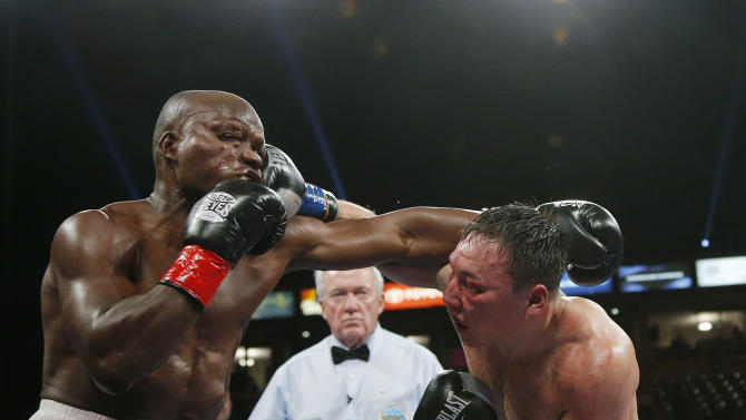 Timothy Bradley, left, takes a punch from Ruslan Provodnikov, of Russia, in the 10th round of a WBO welterweight title boxing match in Carson, Calif., Saturday, March 16, 2013. (AP Photo/Jae C. Hong)