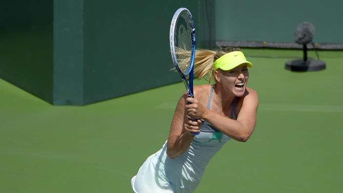 Maria Sharapova, of Russia, returns against Caroline Wozniacki, of Denmark, during their match at the BNP Paribas Open tennis tournament on Sunday, March 17, 2013, in Indian Wells, Calif. (AP Photo/Mark J. Terrill)