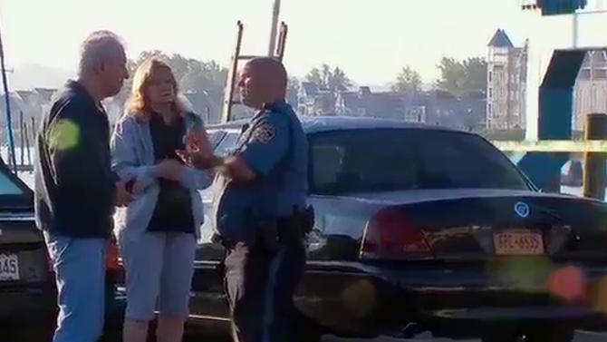In this still frame made from WABC-TV video, Carol Stewart, center, mother of missing woman Lindsey Stewart, speaks to an official about the ongoing search for her daughter following a boating accident on the Hudson River near Piermont, N.Y. on Saturday, July 27, 2013. The Coast Guard says the recreational boat struck a barge near the Tappan Zee Bridge on Friday night, sending two people into the water who haven't been found and injuring four others. (AP Photo/WABC-TV)