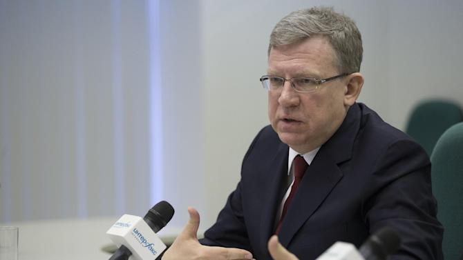 Alexei Kudrin gestures during a news conference in Moscow, Russia, Monday, Dec. 22, 2014. Alexei Kudrin, Russia's finance minister in 2000-2011, has predicted a major economic crisis in Russia next year even if the prices on oil, the backbone of the Russian economy, go up. (AP Photo/Pavel Golovkin)