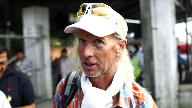 American Glen Plake, a survivor of a weekend avalanche at Mount Manaslu in the Himalayas arrives at the Tribhuwan domestic airport  in Katmandu, Nepal, Wednesday, Sept. 26, 2012. Rescuers have so far brought down the bodies of eight victims, four French, one each from Germany, Italy and Spain, and a Nepali guide. The climbers killed were part of a crush of mountaineers who came to the peak in Nepal because of heightened tensions between Chinese authorities and Tibetans. (AP Photo/Niranjan Shrestha)