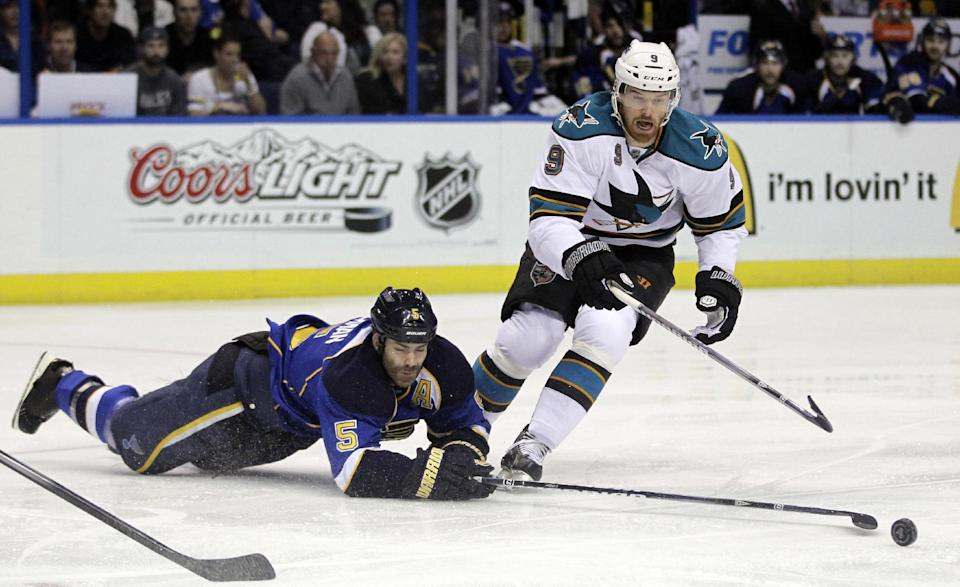 St. Louis Blues' Barret Jackman, left, and San Jose Sharks' Martin Havlat, of the Czech Republic, chase after a loose puck during the first period in Game 5 of an NHL first-round playoff series hockey game on Saturday, April 21, 2012, in St. Louis. (AP Photo/Jeff Roberson)