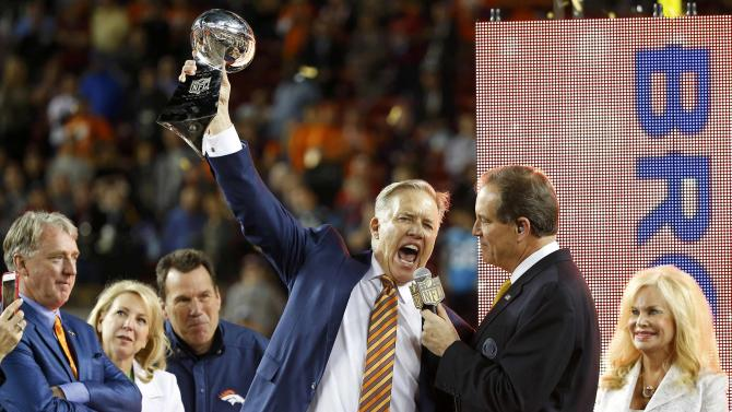 Denver Broncos President and General Manager John Elway holds the Vince Lombardi Trophy after the Broncos defeated the Carolina Panthers in the NFL's Super Bowl 50 football game in Santa Clara