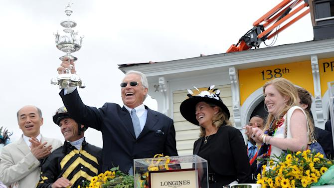 IMAGE DISTRIBUTED FOR LONGINES - Trainer D. Wayne Lukas, with trophy, jockey Gary Stevens, second left, and Erin Kelley, right, daughter of owner Brad Kelley, celebrate after their horse Oxbow won the 138th Preakness Stakes, Saturday, May 18, 2013, in Baltimore, MD. Longines, the Swiss watchmaker known for its famous timepieces, is the Official Watch and Timekeeper of the 138th annual Preakness Stakes. (Diane Bondareff/Invision for Longines/AP Images)