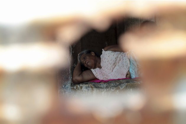 Alvarado takes a nap at her home, which is the ruins of a shoe store in California building that was damaged by the 1972 earthquake, in the old centre of Managua