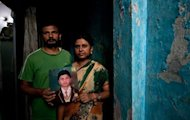 Pinky and Dinesh Kumar Singh pose with a photograph of their missing child Shivam Singh at their residence in New Delhi, on September 12. Thirteen-year-old Shivam Singh promised his mother he would be back to do his homework as he ran to get some sweets. He never returned, becoming one of the 50,000 children who go missing every year in India
