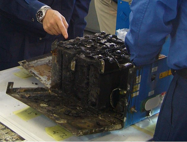 In this Jan. 26, 2013 photo provided by the Japan Transport Safety Board (JTSB), the distorted main lithium-ion battery of the All Nippon Airways' Boeing 787 which made an emergency landing, in disman